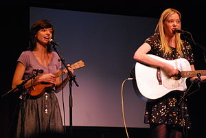 "Garfunkel and Oates - Kate Micucci (""Oates"") and Riki Lindhome (""Garfunkel"") performing at w00tstock in The Coronet Theater, Los Angeles, California."