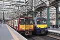 Glasgow Central - Abellio 314202 and 320301.JPG