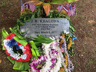 J. R. Kealoha - Grave marker of J. R. Kealoha. Adorned with sacred maile lei, a koa branch and other offerings after the dedication ceremony