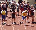 Grayson getting into the blocks for the 100 meter sprint at disticts 2007.jpg