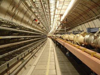 HERA (particle accelerator) - A small segment of the HERA tunnel. The proton beam is travelling in the large vacuum tube in the middle to the right, the electron beam tube is below that.