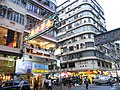 HK Mong Kok Bute Street evening corner buildings Tong Lau shop signs Okashiland Sept-2012.JPG