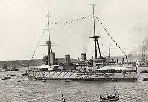 HMAS Australia (1911) - Australia, Sydney, and Melbourne shortly after the Australian fleet unit's first entry into Sydney Harbour. The near ship's torpedo net supports are visible along the hull.