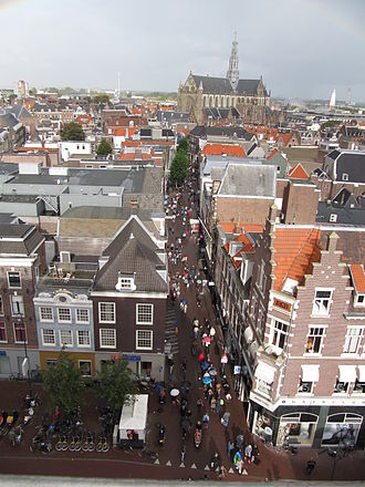 Grote Houtstraat - The older half of the Grote Houtstraat from the corner of the Gedempte Oude Gracht looking North towards the Grote Markt and the St. Bavochurch