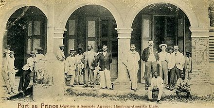 Staff of the German legation and the Hamburg-Amerika Line agency at Port-au-Prince, Haiti in 1900. The agency was involved in the staffing and management of the legation. German nationals were comparatively numerous in Haiti and heavily involved in the Haitian economy until World War I. Haiti German legation 1900.jpg