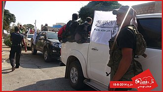 Hazzm Movement - A convoy of Hazzm Movement fighters in the town of Mare' on 18 August 2014.