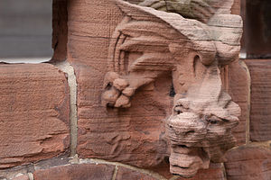 Herman Behr Mansion - One of the sandstone dragons at street level on the Herman Behr Mansion