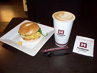"""Hudsons Coffee - A Hudsons Coffee Gourmet Breakfast Bagel and Tall size latte. These """"New York"""" style bagels were introduced nationwide in April 2013."""