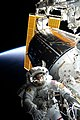 ISS-60 EVA-1 (f) Nick Hague tethered to the forward end of the ISS.jpg
