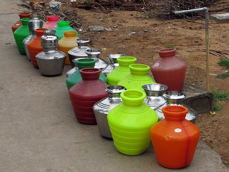 File:India - Colours of India - 014 - Water pots lined up for filling (1396028598).jpg