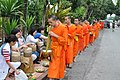 It's a wonder all the monks in the line manage to get something (14419205818).jpg