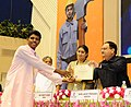 J.P. Nadda and the Union Minister for Textiles, Smt. Smriti Irani present the certificate to the RPS candidate, at the 2nd Anniversary Celebrations of the Skill Indian Mission, on the occasion of the World Youth Skill Day.jpg