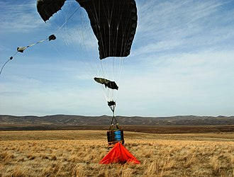 Joint Precision Airdrop System - A JPADS guided bundle lands right next to its programmed target, indicated by the orange marker