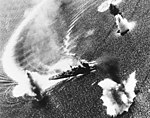 Japanese cruiser Nachi maneuvering under air attack in Manila Bay, Philippines, on 5 November 1944 (80-G-287018).jpg