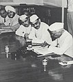Jawaharlal Nehru signing the report of the Planning Commission on the First Five Year Plan, New Delhi, 7 July 1951.jpg