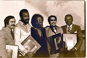 Peoples Temple in San Francisco - Dr. Carlton B. Goodlett (far right)and Rev. Jim Jones (to Goodlett's left) were recipients of the Martin Luther King, Jr. Humanitarian award given at Glide Memorial Church January 1977.