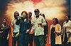Joan Armatrading, Kingdom Chorus Singers and Nelson Mandela wearing LSE cap, 2000.jpg