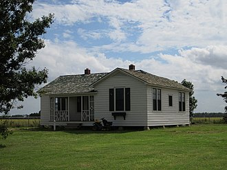 Johnny Cash - Cash's boyhood home in Dyess, Arkansas, where he lived from the age of three in 1935 until he finished high school in 1950. The property, pictured here in 2013, is listed on the National Register of Historic Places.