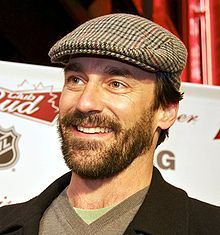A close-up of Hamm smiling wearing a hat