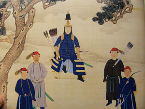 Kangxi Emperor - The Kangxi Emperor in ceremonial armor, armed with bow and arrows, and surrounded by bodyguards.