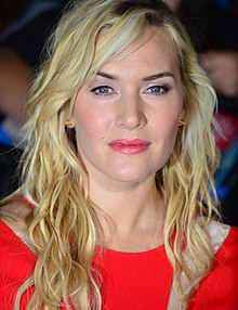 A close-up shot of Kate Winslet's face at the premiere of Divergent in 2014.
