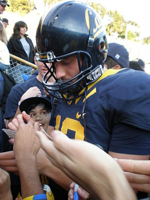 Cal quarterback Kevin Riley is mobbed by fans ...