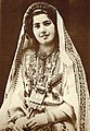 Khalil Raad, Ruth Raad in the traditional costume of Ramallah, ca. 1943.jpg