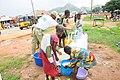 Kids fetching water in after school wears.JPG