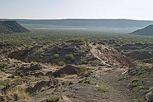Kilbourne Hole - A view of the Kilbourne Hole from the trail at the southwest corner.  Everything visible in this photo is the maar, bottom lands and rim with basalt cliffs.