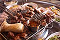 Korean barbecue - moksal, samgyeopsal, beoseot, and meljeot on a gridiron.jpg