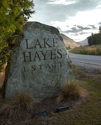 Lake Hayes Estate - Stone sign at the entrance