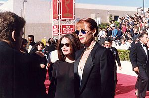 Lauren Holly - Holly with Holly Marie Combs (left) at the 1993 Emmy Awards