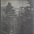 Left-half of a landscape stereograph picturing a view of a lake (34184776544).jpg