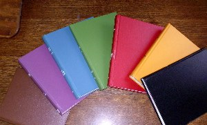 Library binding - The buckram used to cover library bound books comes in a variety of colors.