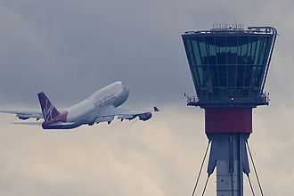 Heathrow's control tower with a departing Virgin Atlantic Boeing 747-400 in the background. London Heathrow tower and Virgin B747 (5048342074) (2).jpg