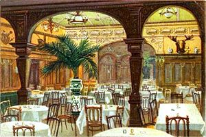"Lüchow's - Luchow's ca. 1902: ""Garden"" as seen from ""Cafe"" showing the effect created by skylights added in the extensive 1902 construction. The big arched opening at the rear is actually a mirror. Gaslights are shown. To the left is the door where the headwaiter stood. Within, right, is the office, later a semi-private dining room."