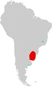 Map of South America marked by red and blue colors, with the red color extending over Uruguay and into Rio Grande do Sul, southern Brazil, and the blue color in southeastern Minas Gerais, eastern Brazil, and in two different areas in northern and southern Buenos Aires Province, eastern Argentina.