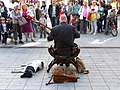 Lyon Street musician with dog and audience 20110418.jpg