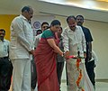 M. Venkaiah Naidu and the Union Minister for Textiles, Smt. Smriti Irani lighting the lamp to inaugurate the Hathkargha Samvardhan Sahayatha Scheme distribution to weavers, at the Swarna Bharat Trust, in Atkur, Vijayawada.jpg