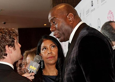 Johnson with his wife, Cookie, in 2014 Magic Johnson Mercedes-Benz Carousel of Hope Gala 2014 (cropped).jpg