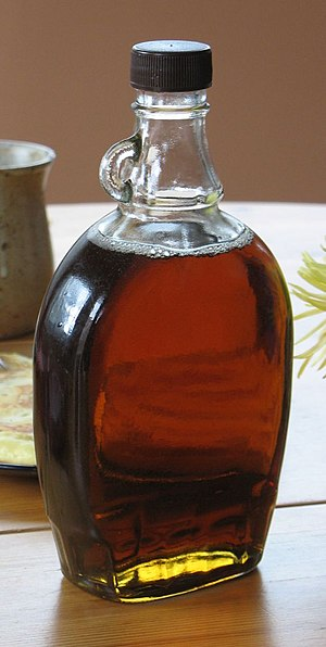 Syrup - A bottle of maple syrup, which is often poured on pancakes and waffles.