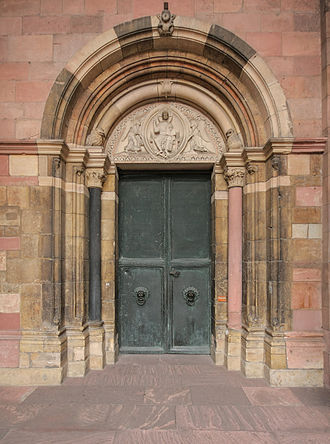 Adalbert of Mainz - Market portal of Mainz cathedral. The liberty privilege for the Mainz citizens is engraved on the bronze wings.