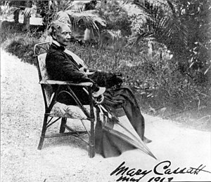 "Mary Cassatt - Cassatt seated in a chair with an umbrella. Verso reads ""The only photograph for which she ever posed."""