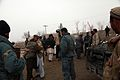 Members from the Afghan National Police (ANP) greet members of the Afghan Local Police (ALP) during a shura in Pul-e Khumri district, Baghlan province, Afghanistan, Feb 120210-A-BT925-017.jpg