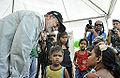 Ministro Celso Amorim conversa com crianças que aguardam o momento de serem maquiadas em Iranduba (AM) (8030636934).jpg
