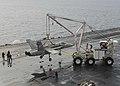 Mobile crash crane with retired FA-18C Hornet aboard USS Nimitz (CVN-68) on 8 December 2017 (171208-N-KR702-057).JPG