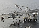 Mobile crash crane with retired FA-18C Hornet aboard USS Nimitz (CVN-68) on 8 December 2017 (171208-N-KR702-057).JPG