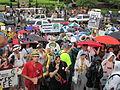 NOLA BP Oil Flood Protest brollys musicians clap.JPG