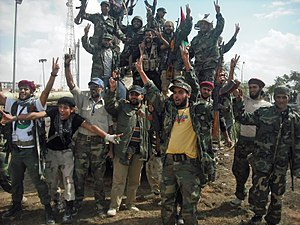 Anti-Gaddafi forces - Libyan rebels after entering the town of Bani Walid.