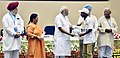Narendra Modi giving away awards to the winners of national essay, painting and film competitions (5).jpg